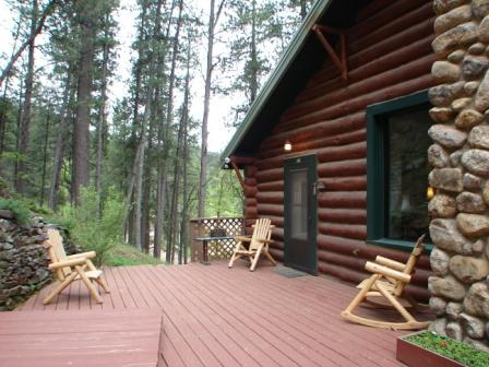 Relax after a day of touring on these comfortable log chairs