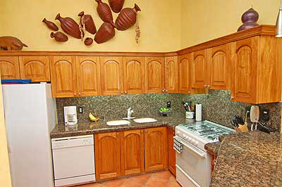 The All Granite Kitchen Is A Gourmet Delight.