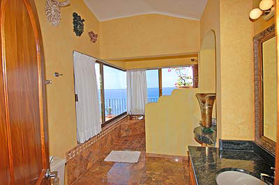 The Master Bath Looks Out To The Ocean....