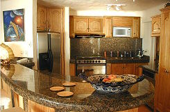 Hand Hewn Granite Graces The Custom Designed Kitchen.