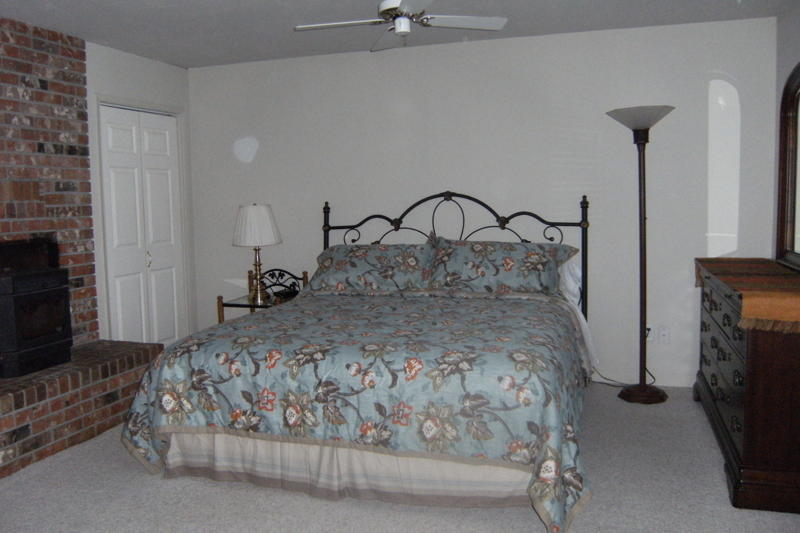 Front downstairs bedroom with king bed