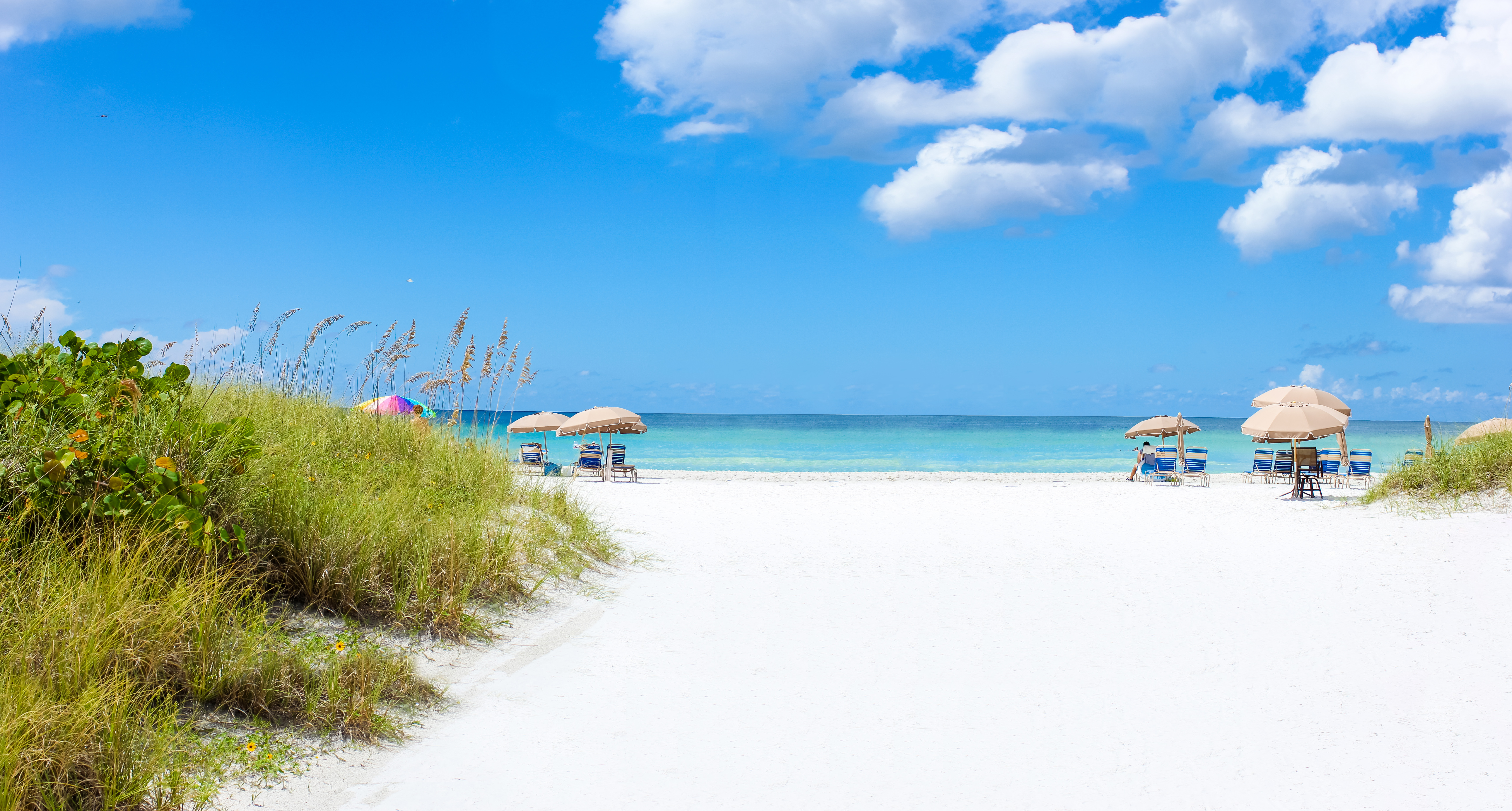 Just steps from the sandy white shores of Crescent Beach on