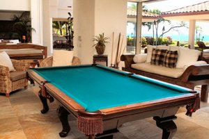 Billiards room with wet bar and stereo system.