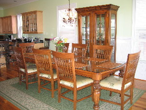 Dining room table seats eight, four more nearby