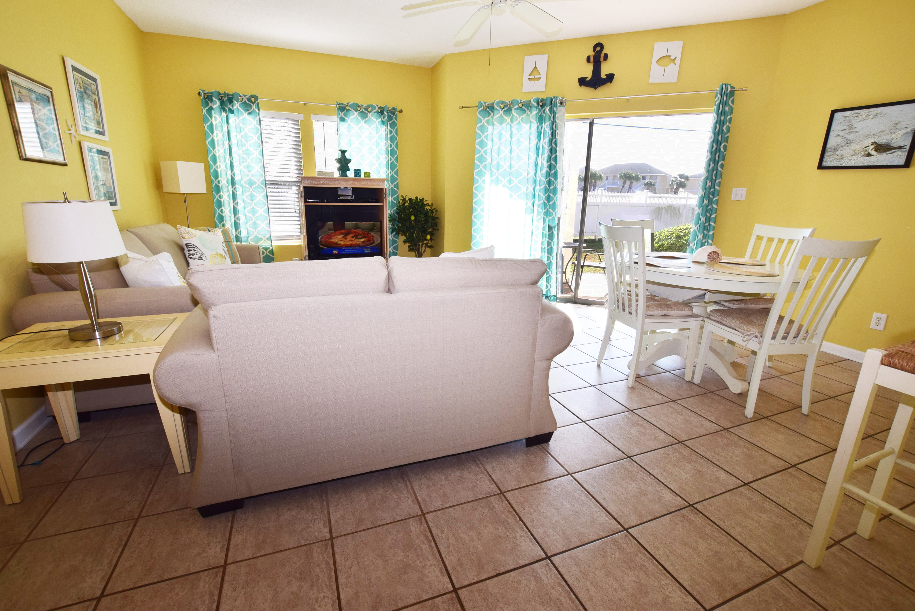 Living Room with walk out patio - Sandpiper Cove Resort 9106 Holiday Isle Destin Florida Vacation Rentals