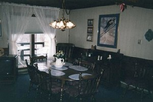 First floor includes living room, dining, kitchen