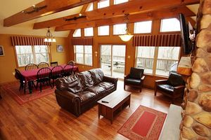 Living Room - Beautiful view of the living room show exposed wooden rafters..