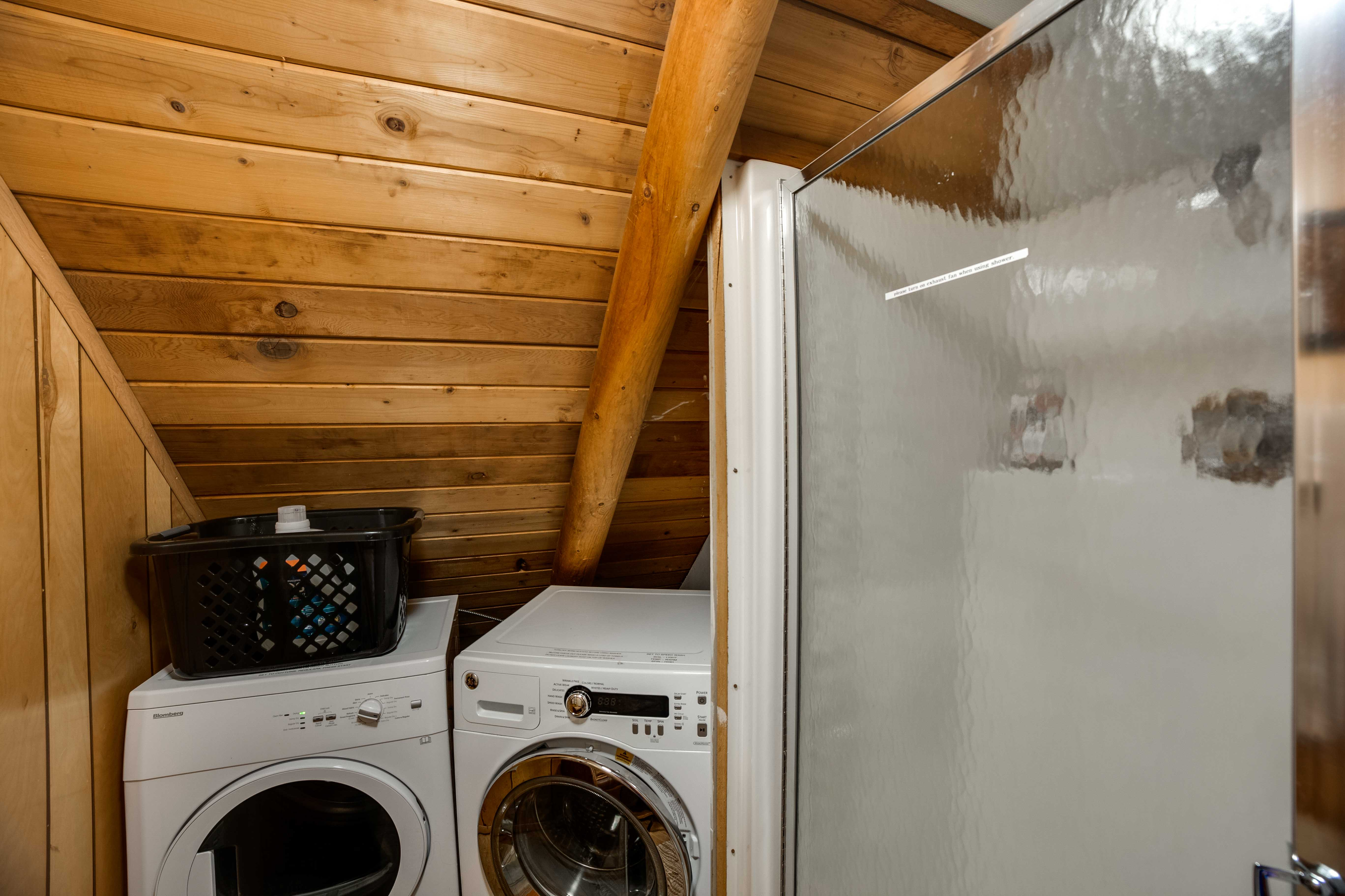 Upstairs laundry area with shower