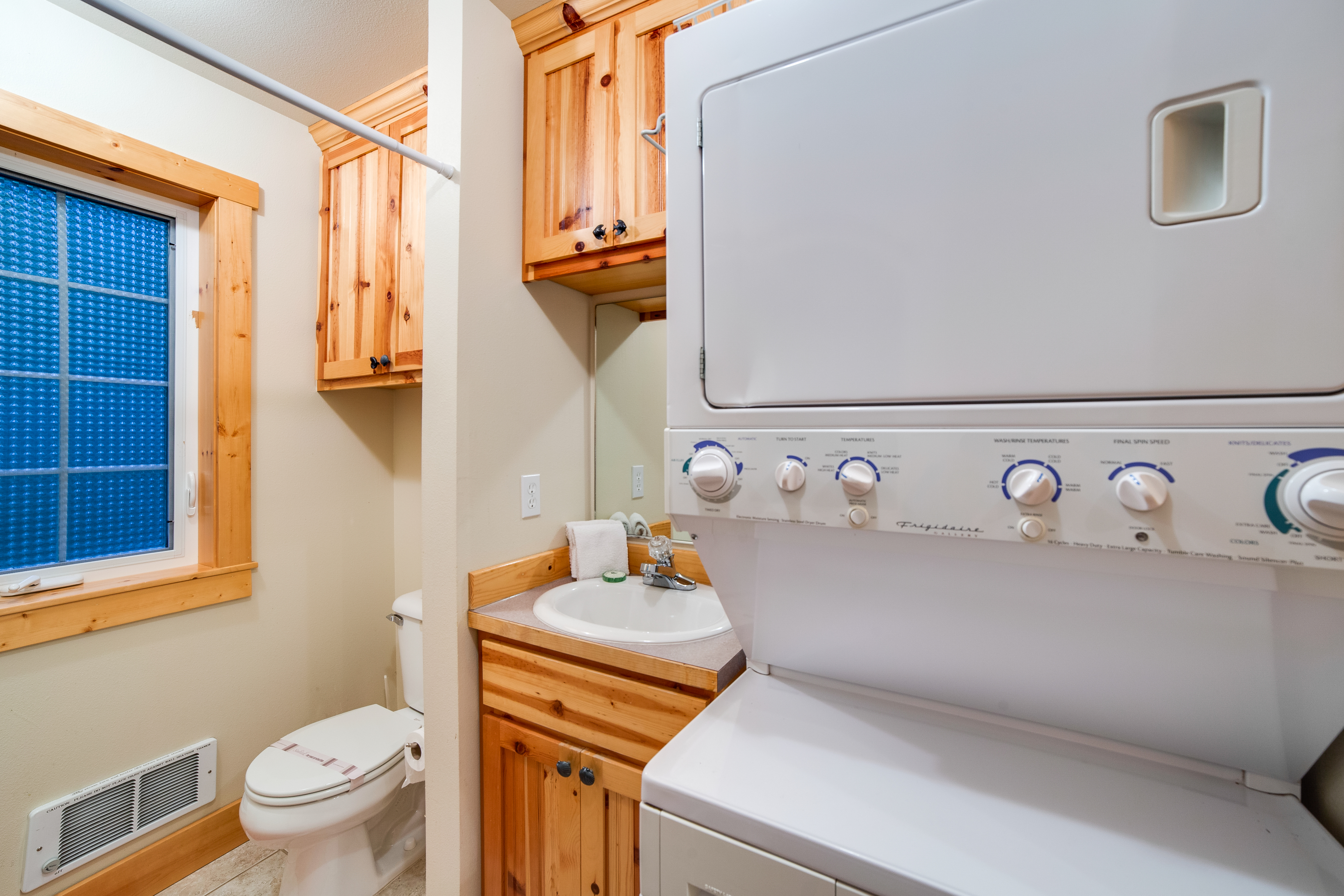 Entry bathroom with laundry area