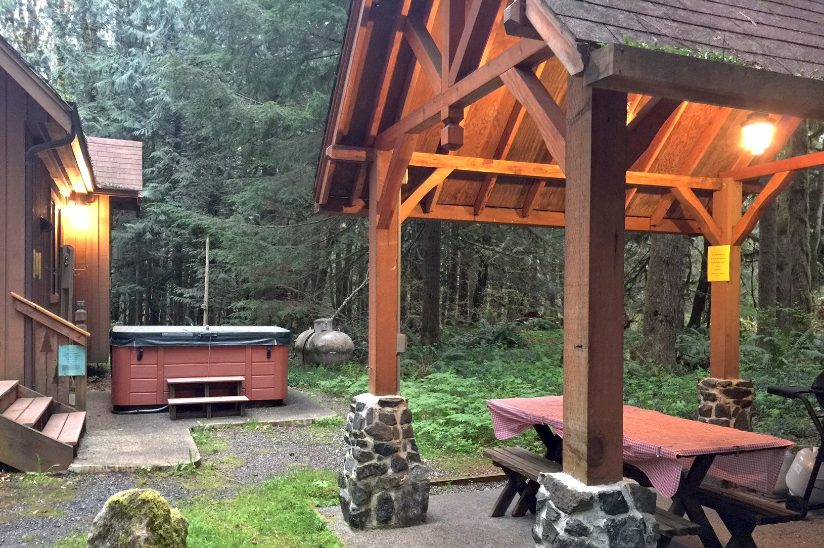 Outside with your private hot tub and sheltered picnic table