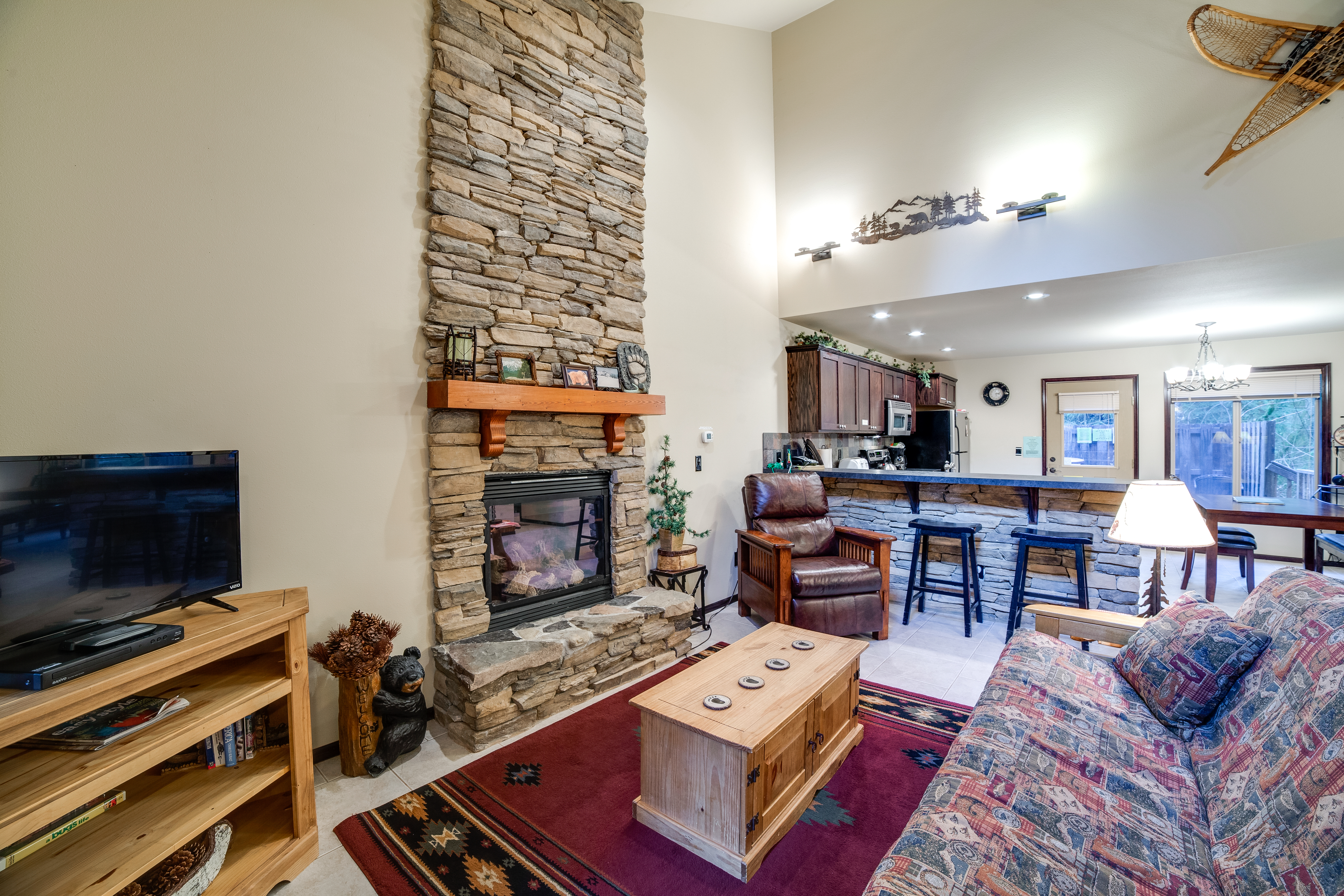Living room with gas fireplace and futon