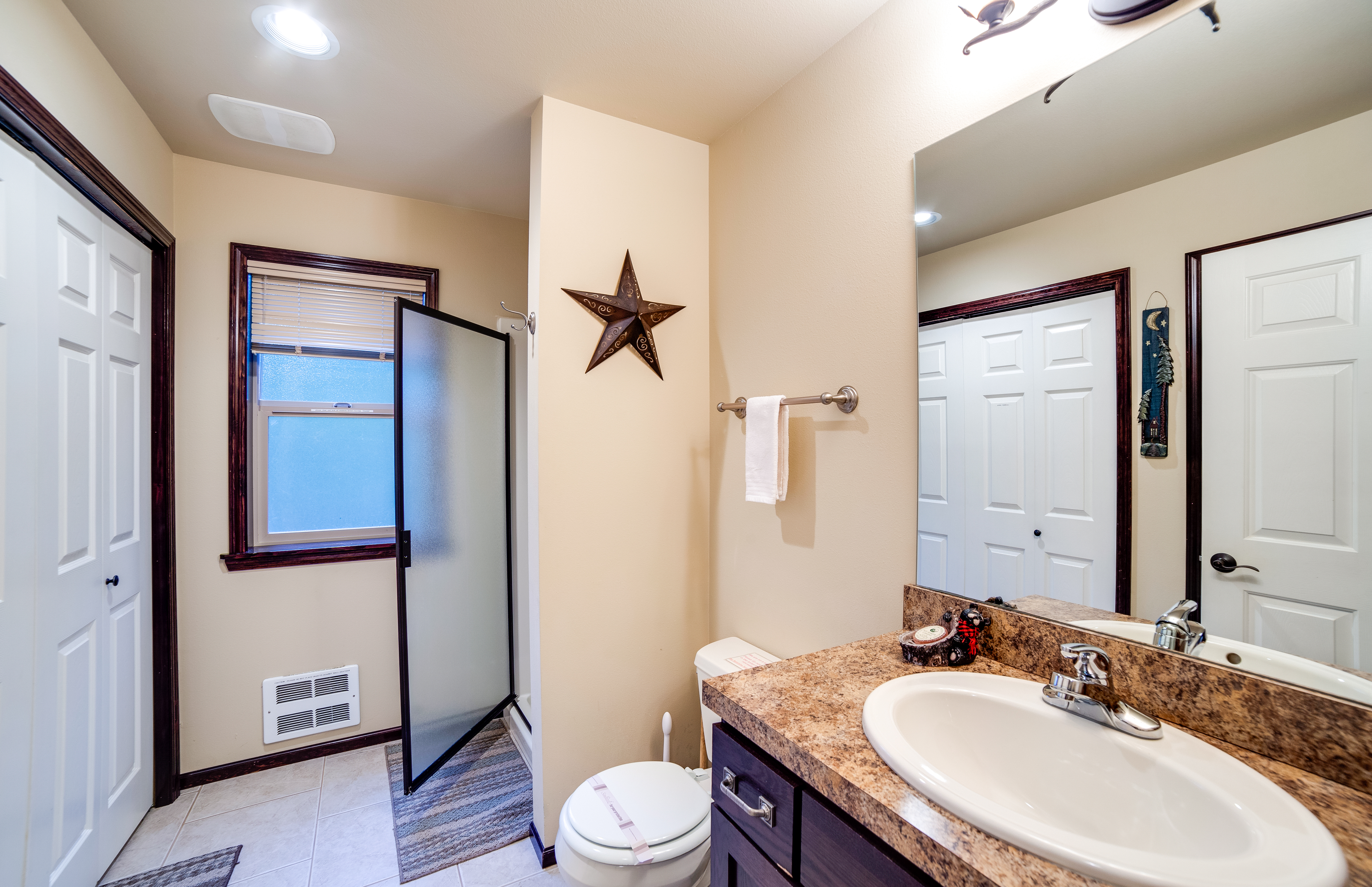 Main bathroom with shower and laundry area