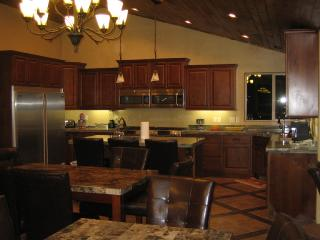 Kitchen: Has 2 stoves, 2 ovens, 2 microwaves, 2 dishwashers,