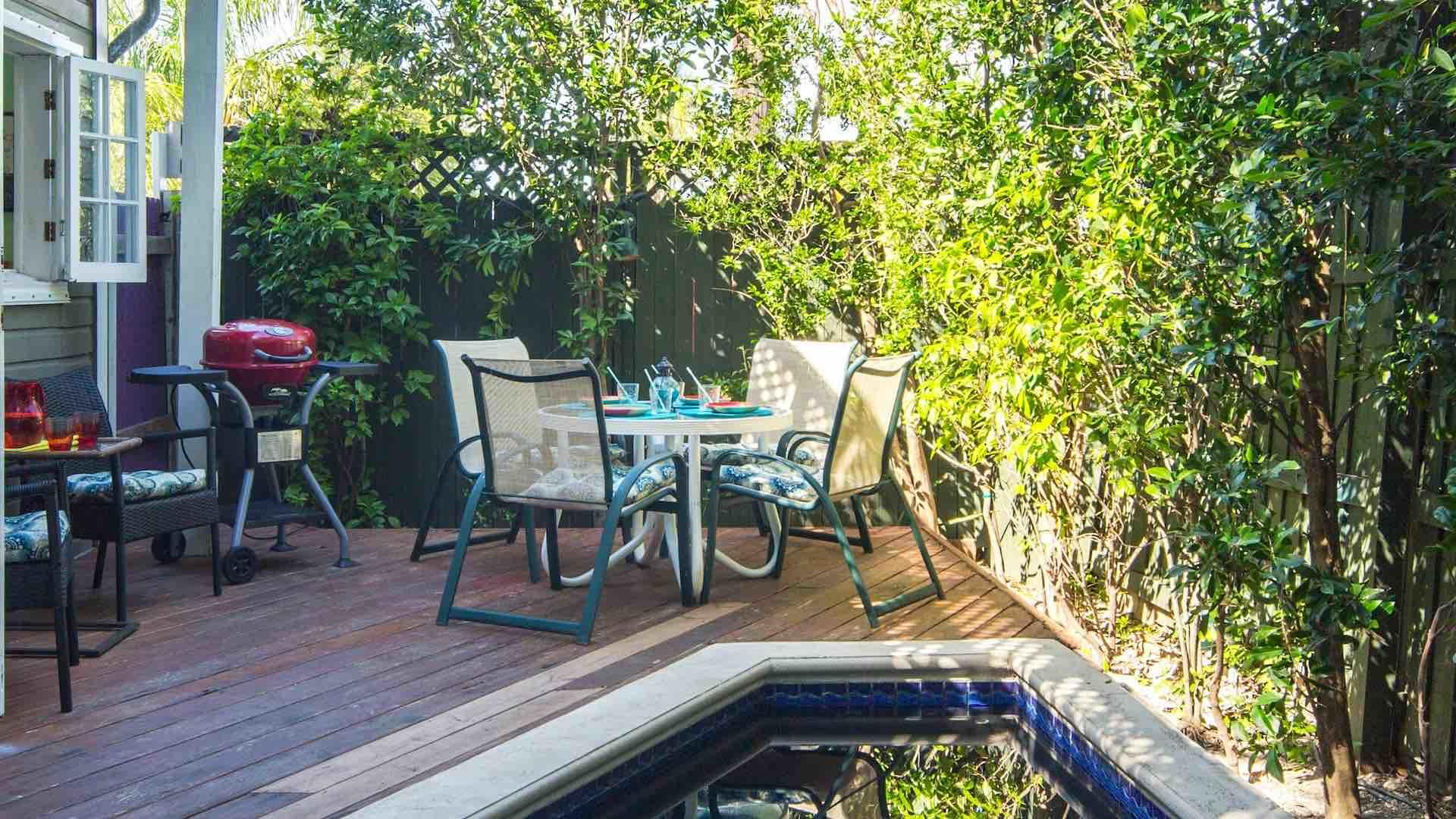 Enjoy a poolside BBQ using the electric grill and outdoor dining set...