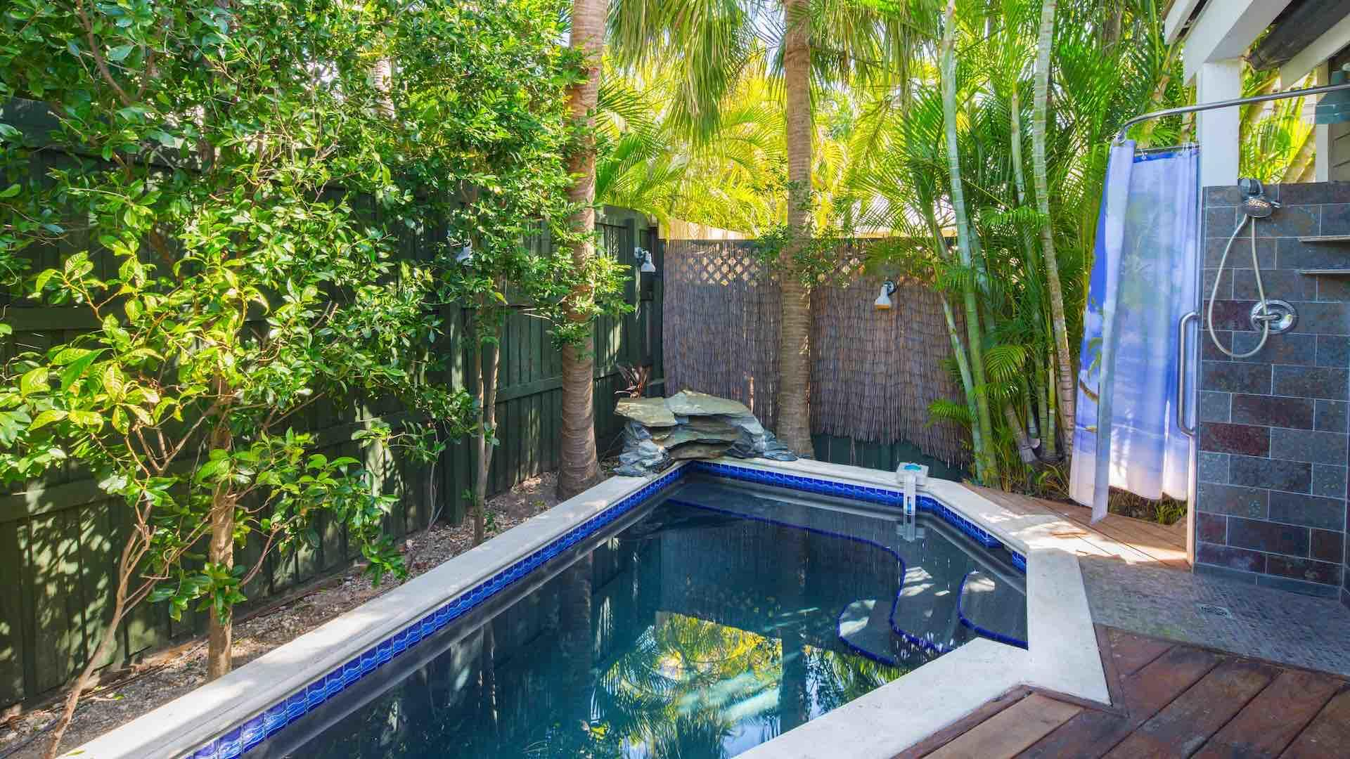 The pool has a soothing waterfall and outdoor shower...