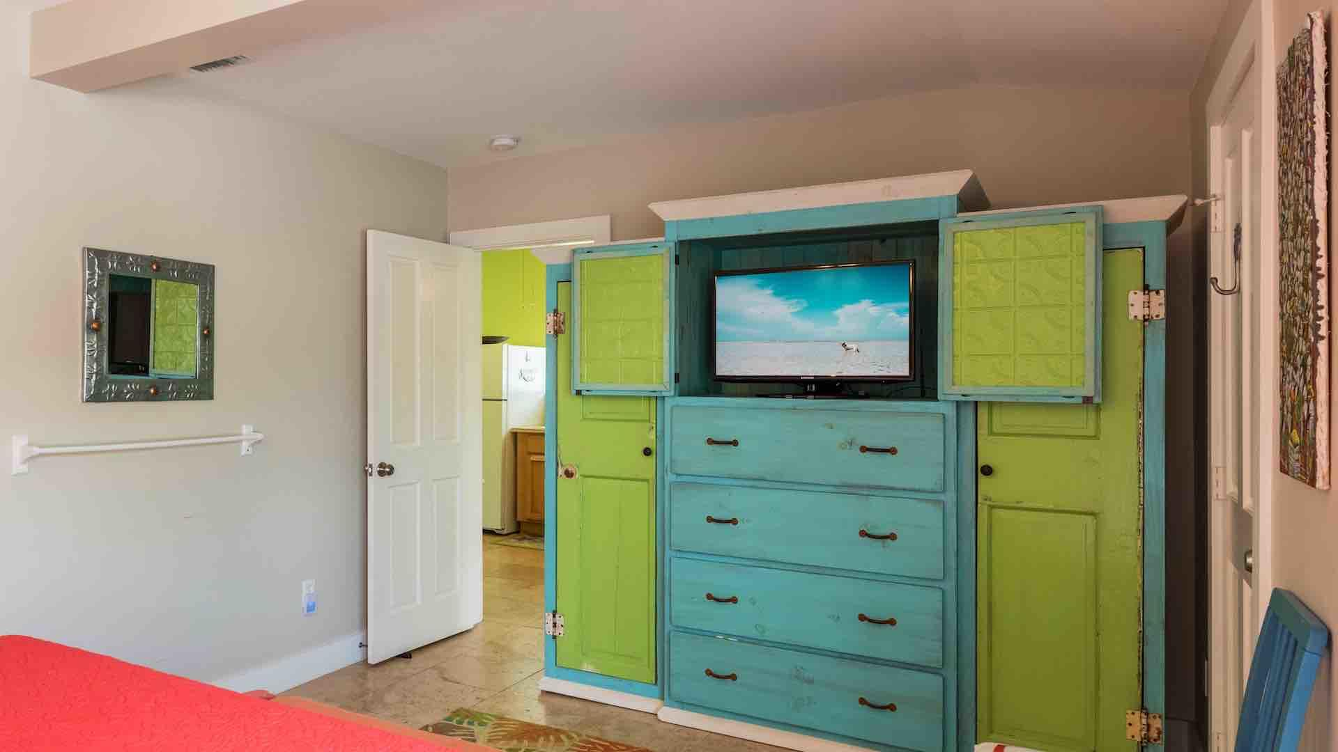 The first bedroom has a flat screen TV and plenty of dresser space...