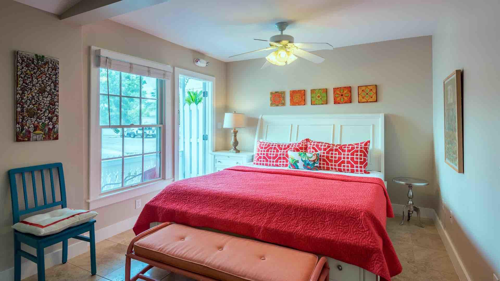 The first bedroom also has an overhead fan and island inspired decor...