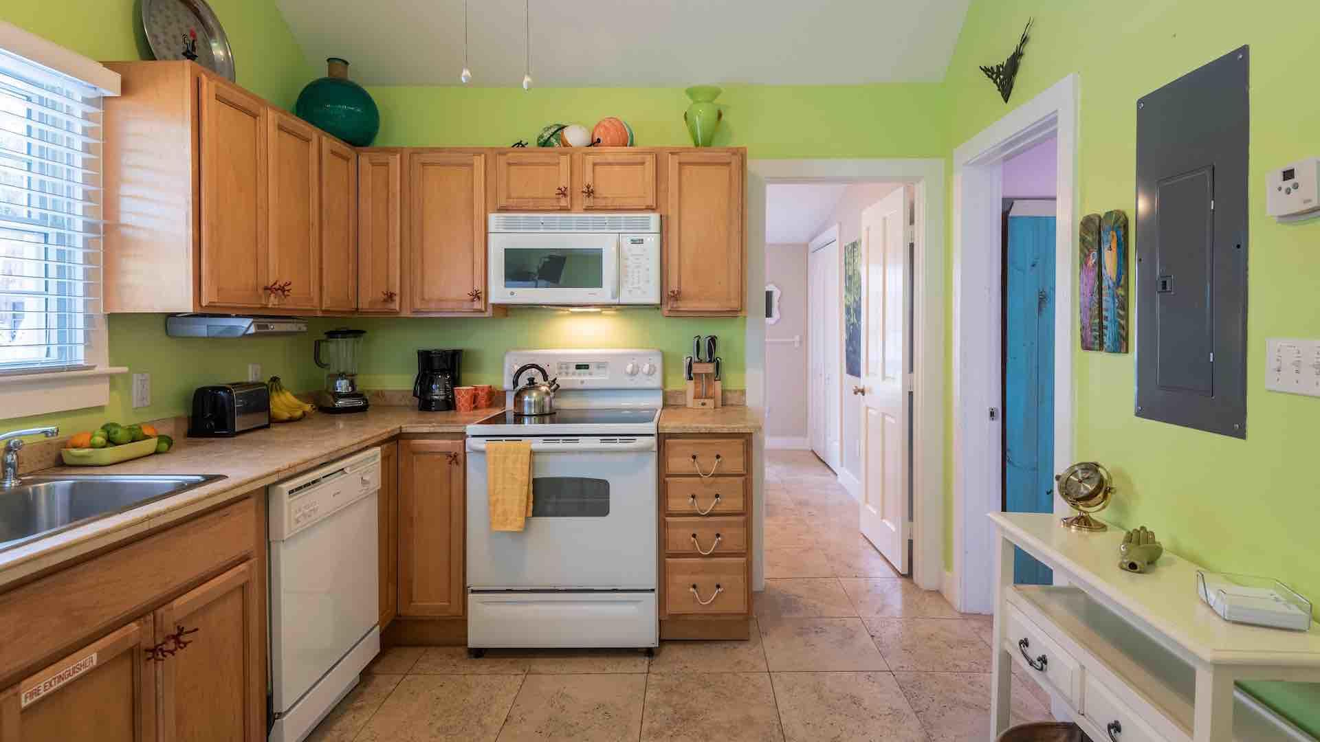 The kitchen is also equipped with an electric stove, oven, and a dishwasher for easy clean up after meals...