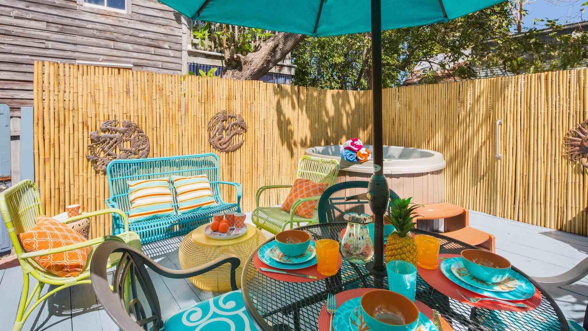 The outdoor dining table seats four and there's additional outdoor lounging options...