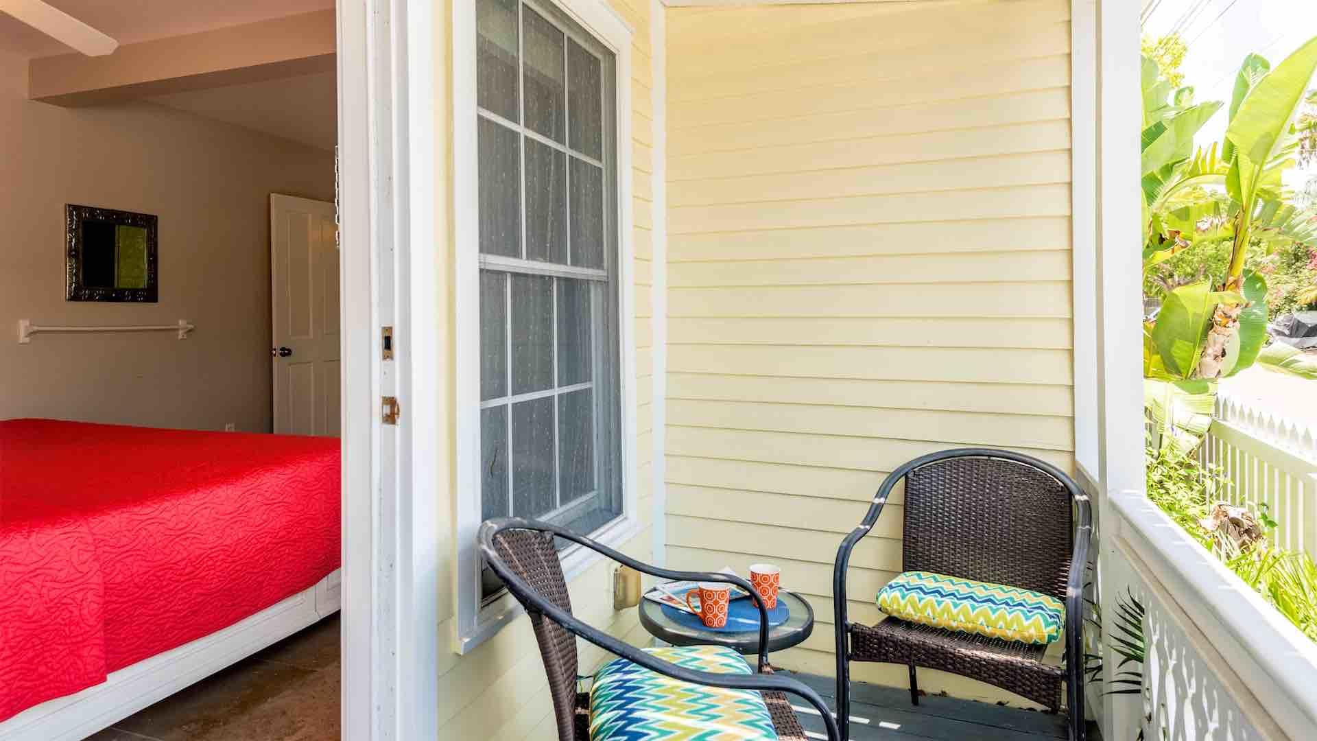 The private balcony has a 3-piece bistro set and overlooks Virginia Street...
