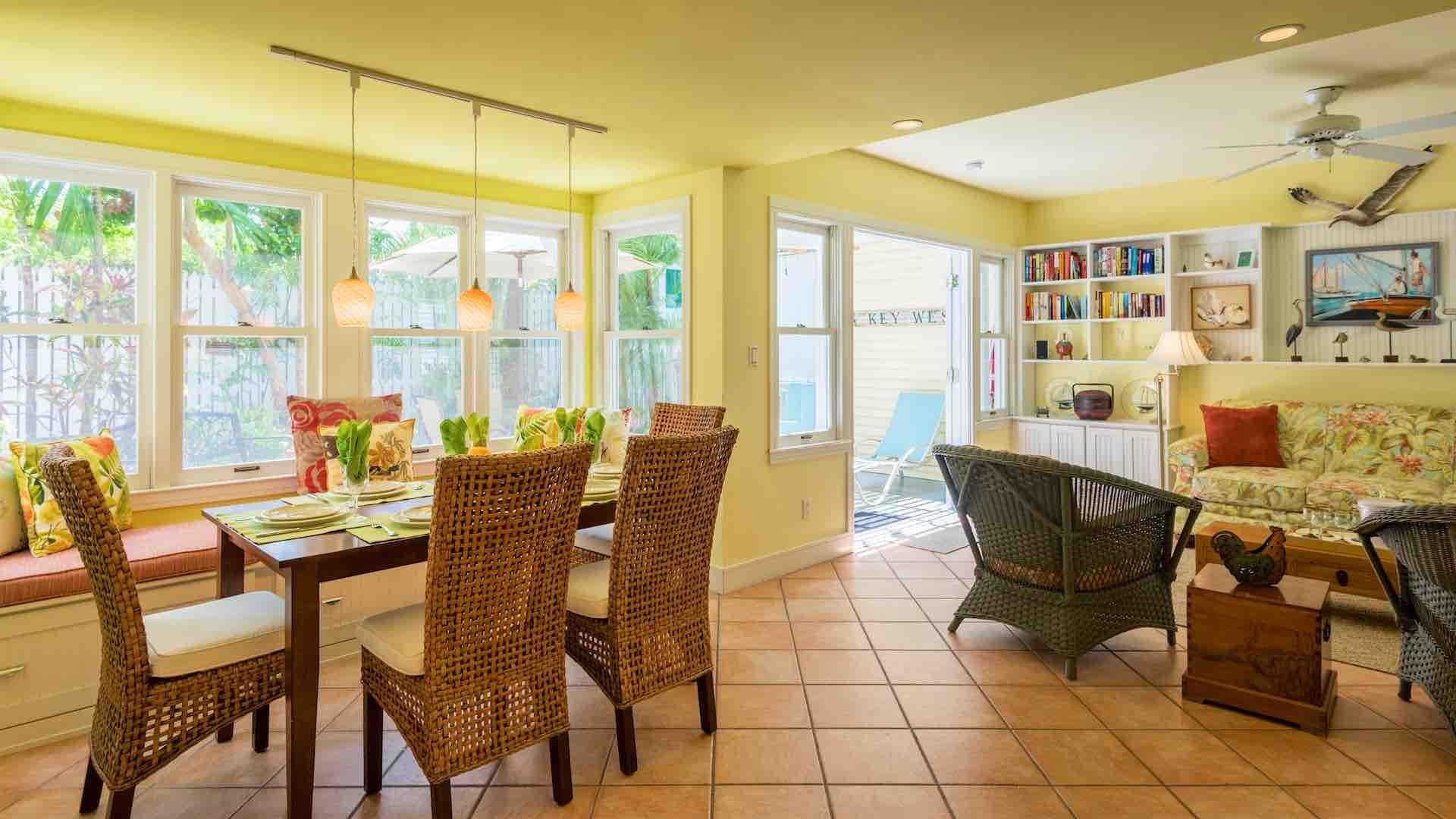 The dining table is situated in the bay window, with seating for six...