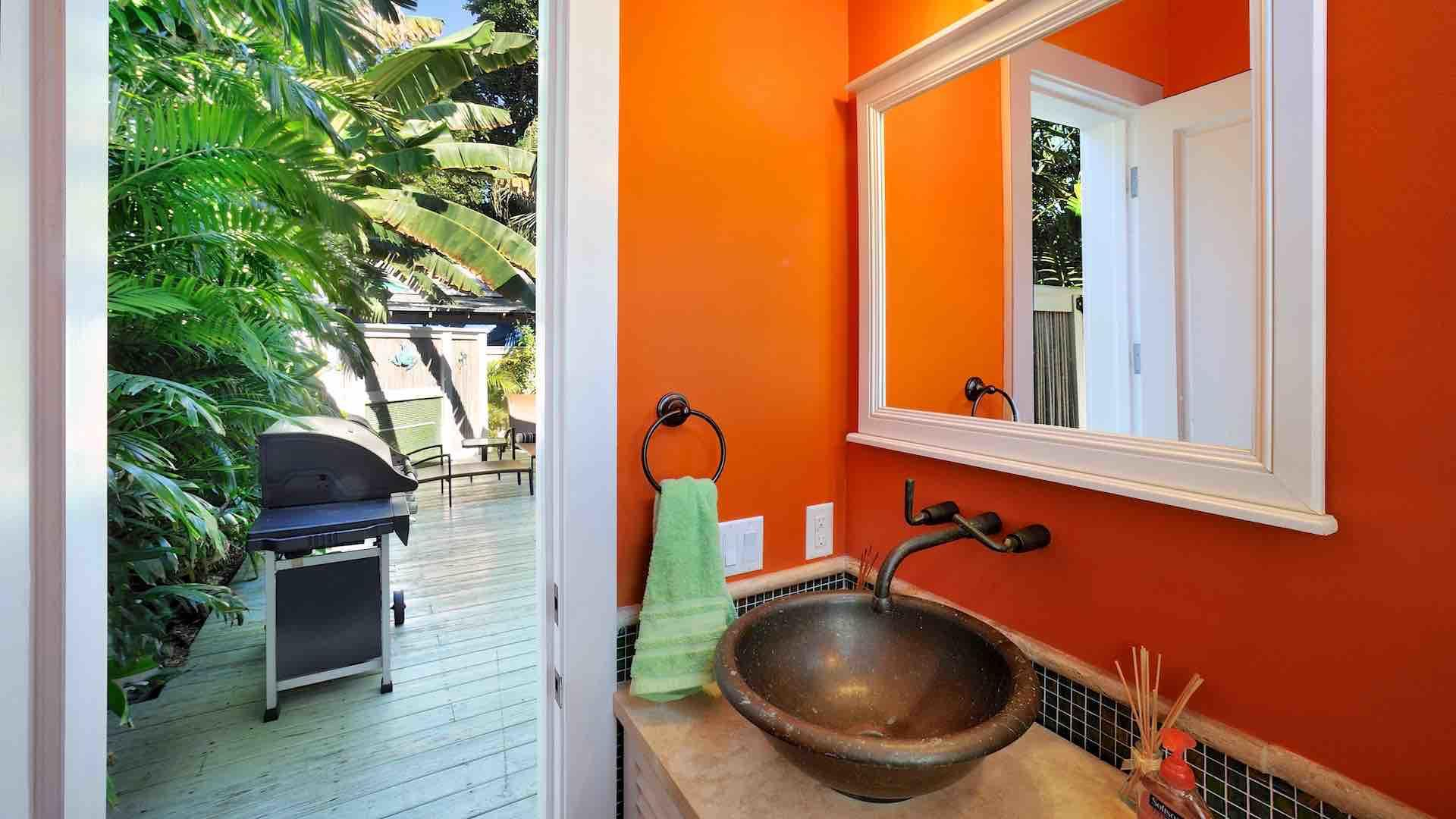 There is a convenient half bath just sets from the pool, and an outdoor shower…