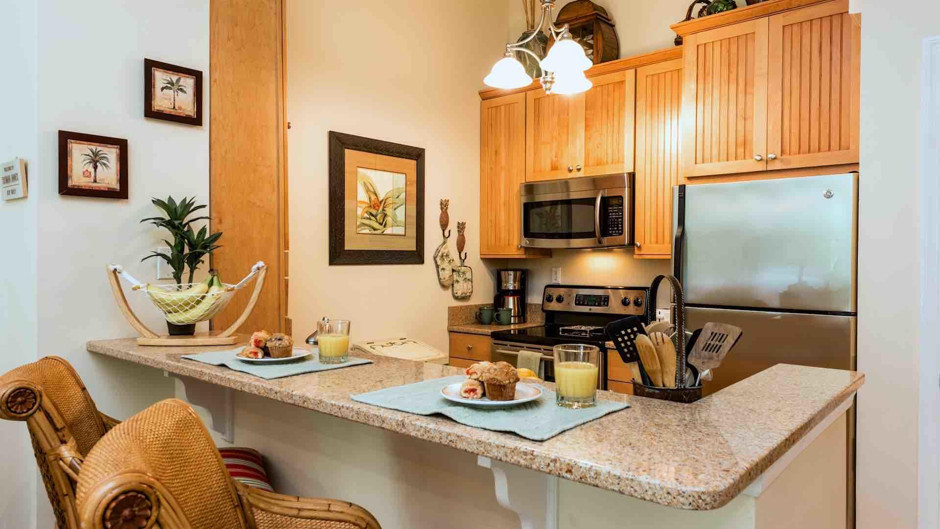 Additional dining or seating for two can be found at the kitchen bar...