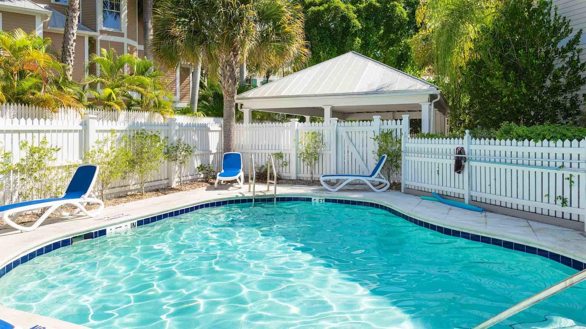 The landscaped community pool is located just across the street...