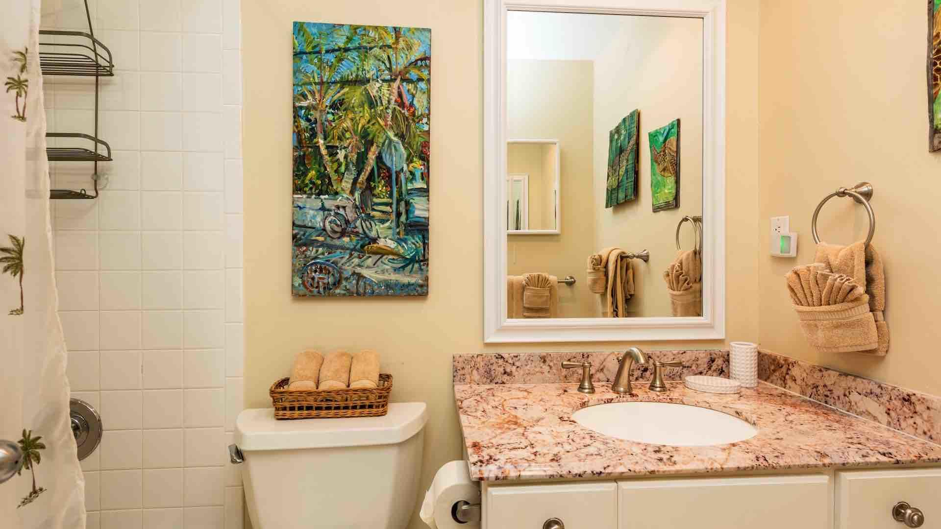 The master bathroom is en suite, with a shower and tub combo...