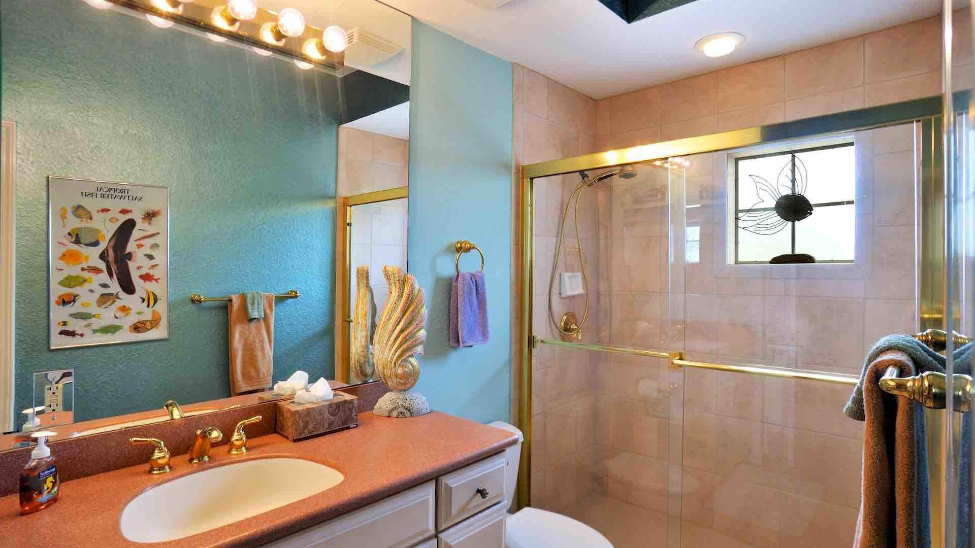 The second bathroom is located between the second and third bedrooms...