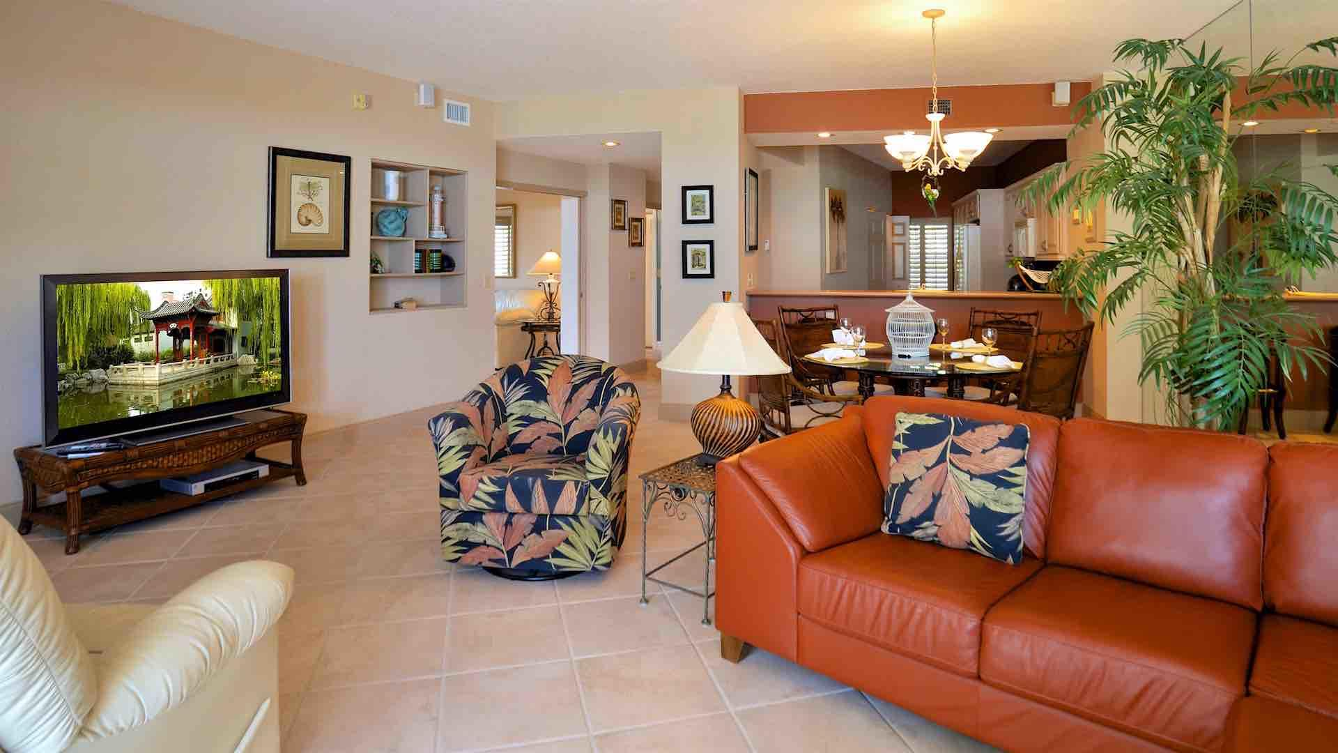 Enjoy watching the large flat screen TV from the various seating options...
