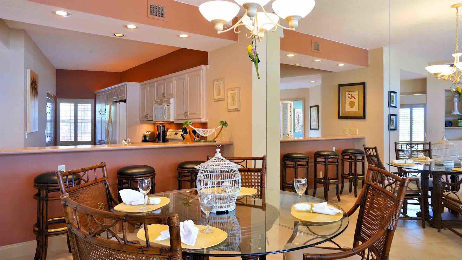 The indoor dining table seats four comfortably and there's additional seating at the kitchen bar...