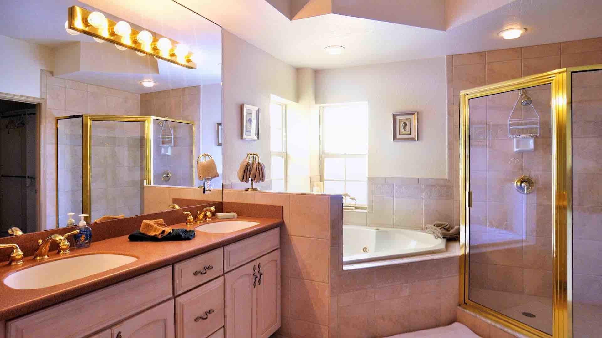 The master bathroom is en suite, with a shower and jacuzzi tub...