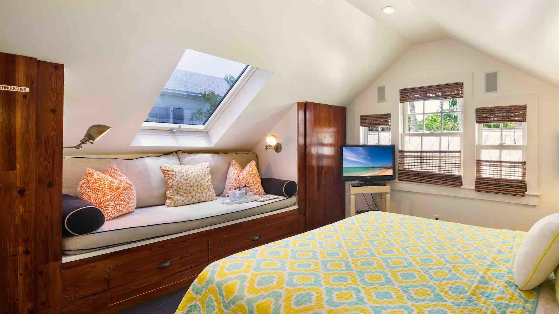 The fourth bedroom also has a flat screen TV and opening skylight...