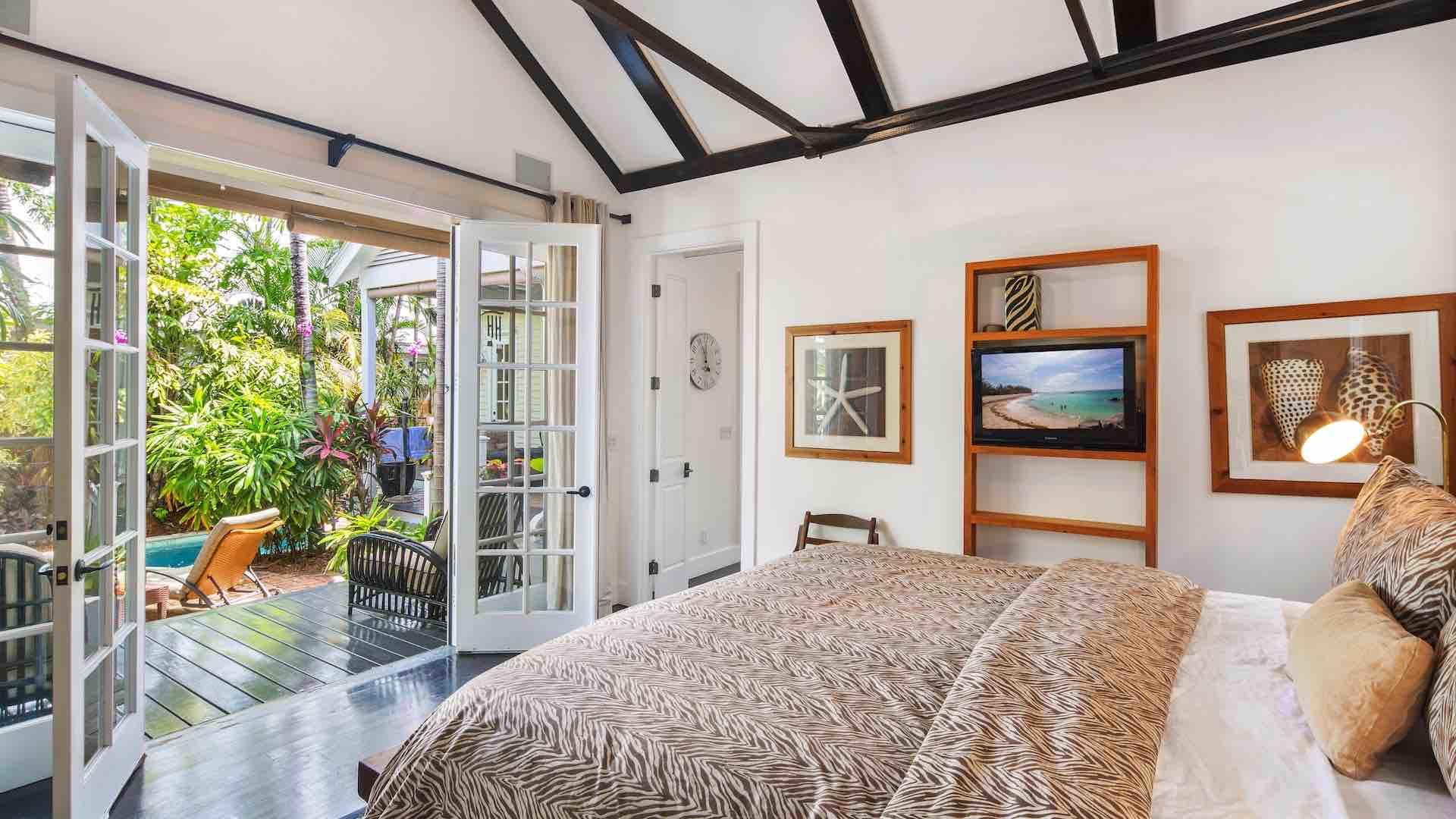 The master bedroom has French doors that open to the pool area...