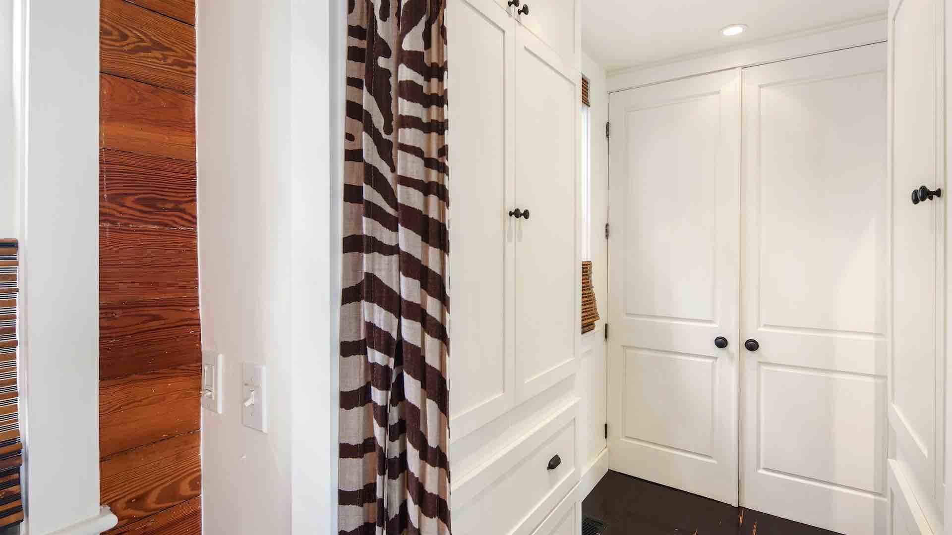 The master bedroom has a large walk-in closet...
