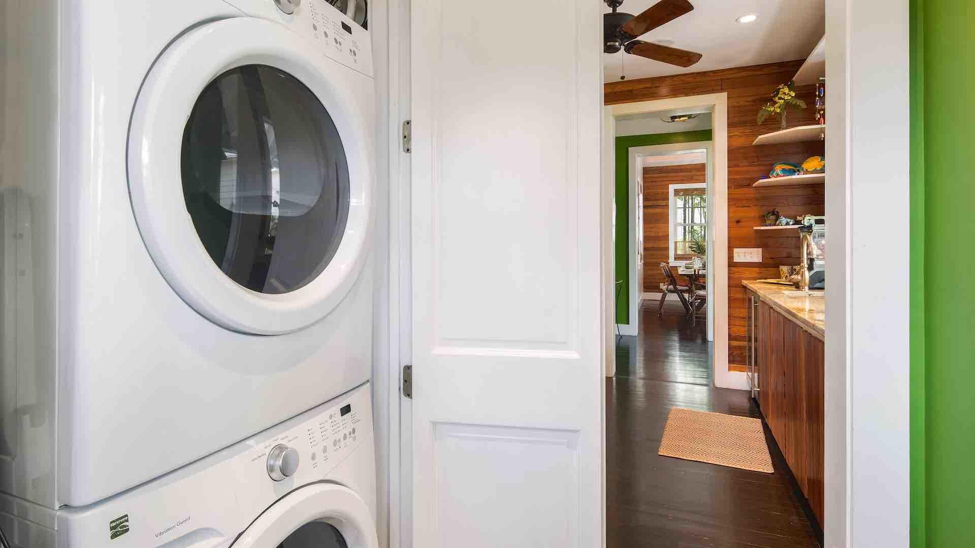 The washer and dryer are located in the hallway next to the kitchen...