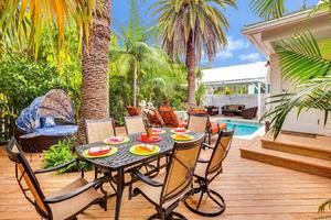 The pool at Casa Oliviana is surrounded by a large deck with 4 seating areas...
