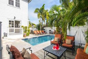 Southernmost Hospitality VII has a spacious back yard with a tall fence surrounding the large private pool...