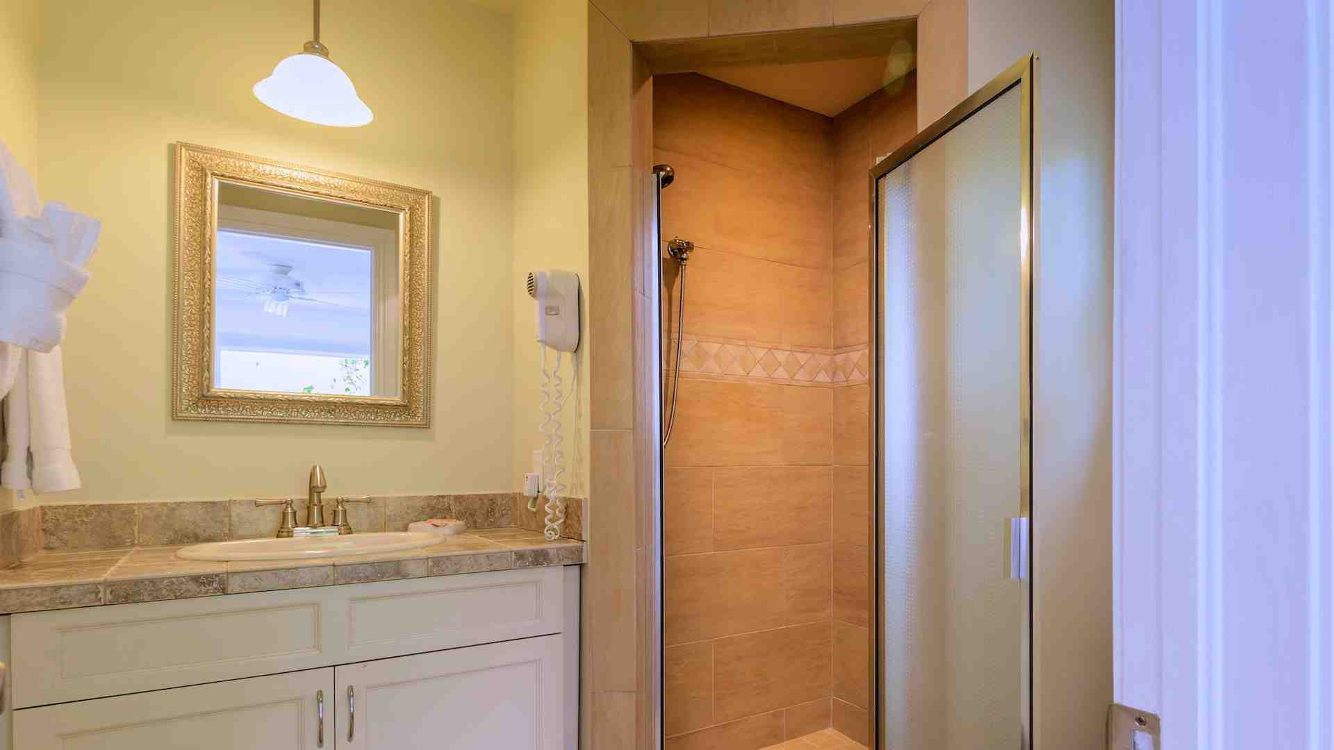 This bathroom is directly off the second bedroom with a glass shower...