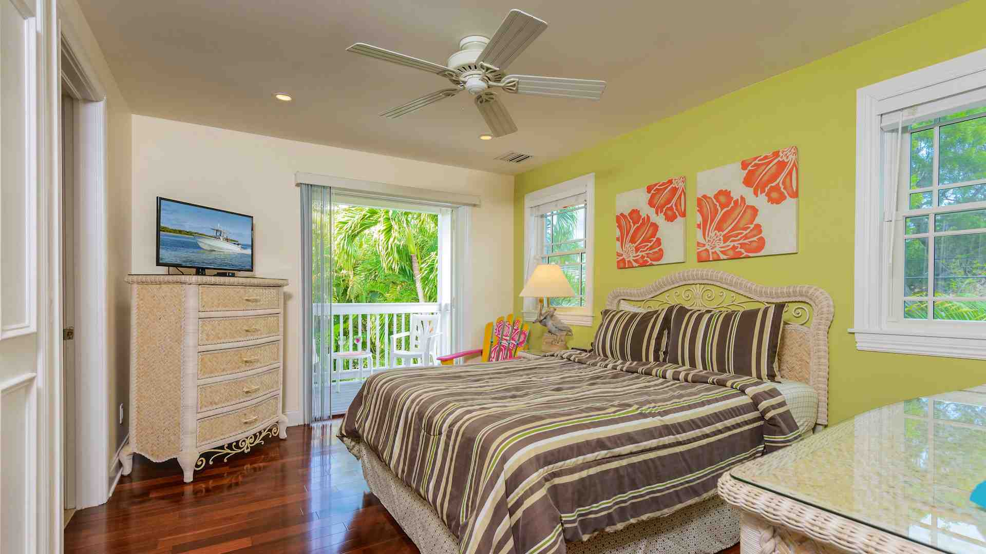 The second bedroom has a queen sized bed, flat screen TV, ceiling fan, balcony...