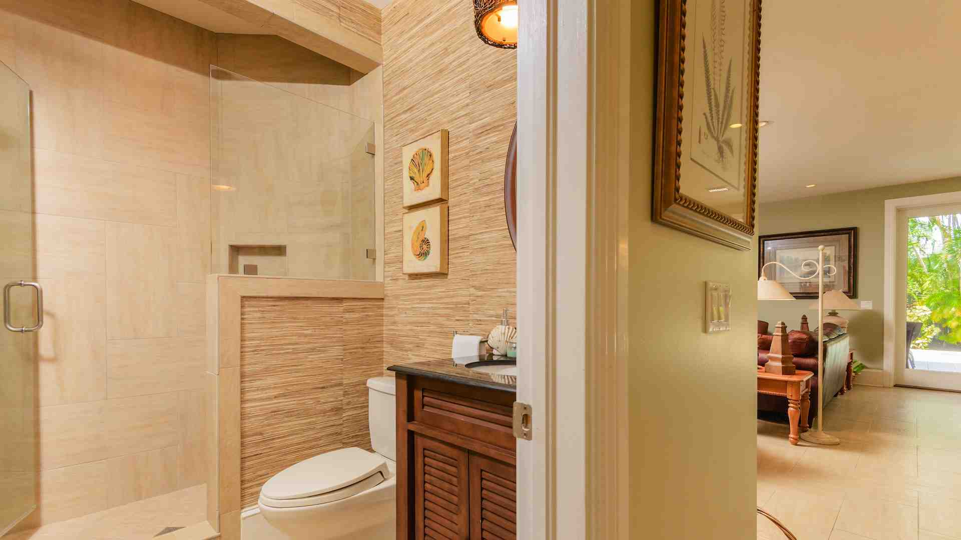 The downstairs bath has a glass shower for rinsing off after the beach or pool...