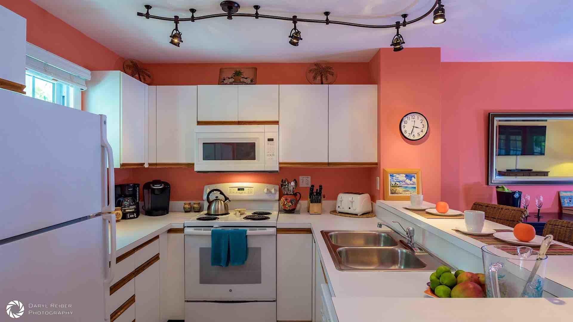 The condo is a vibrant coral, evoking the brilliant colors of the tropics...