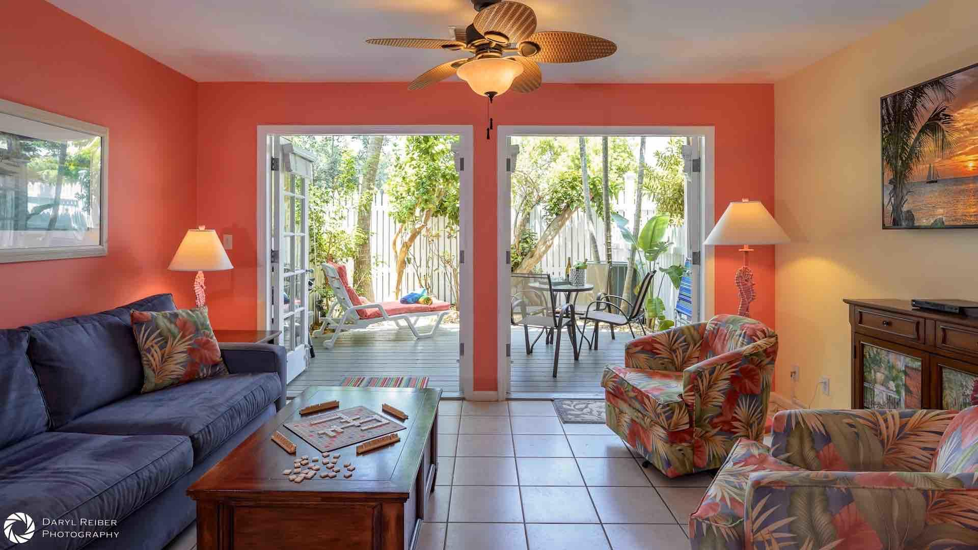 The living room features two sets of French Doors to the back deck...