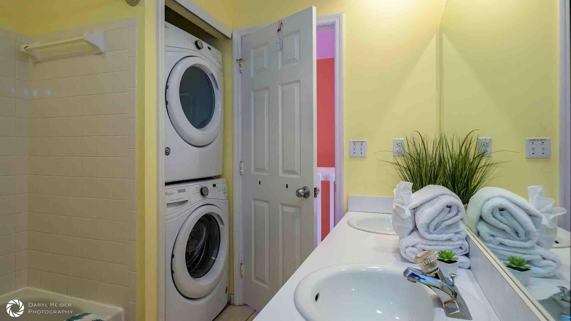 The washer and dryer are also located in the full bathroom...