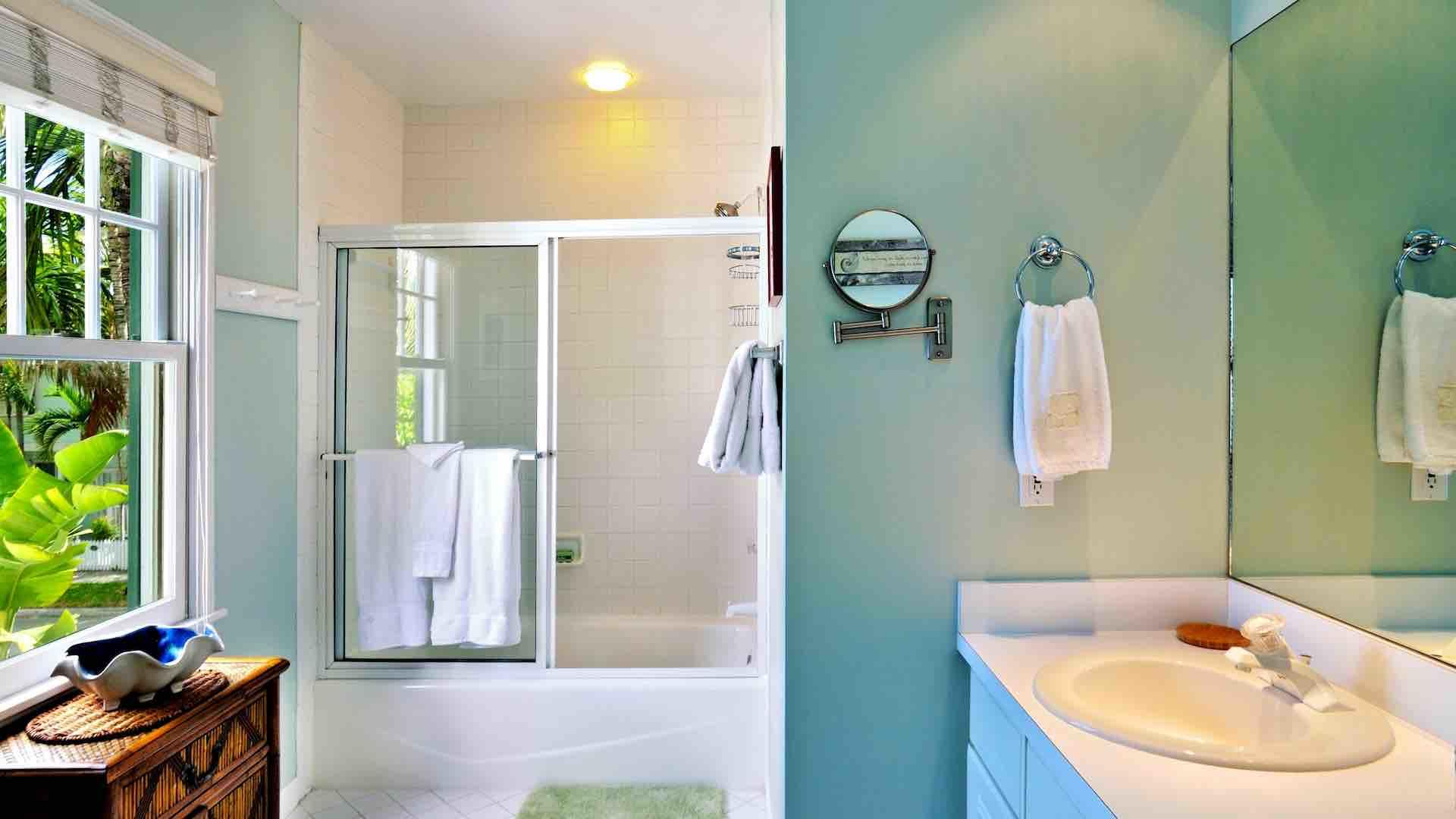 The master bathroom is en suite, with a tub and shower combination...