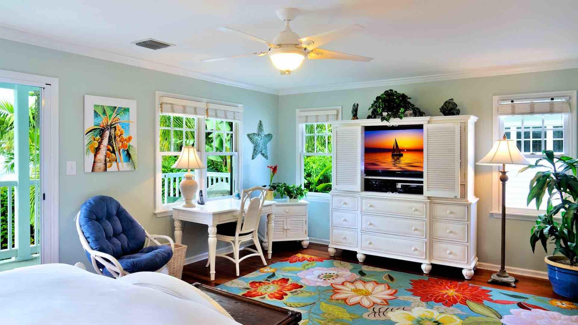 The spacious master bedroom suite features a large flat screen TV and a balcony...