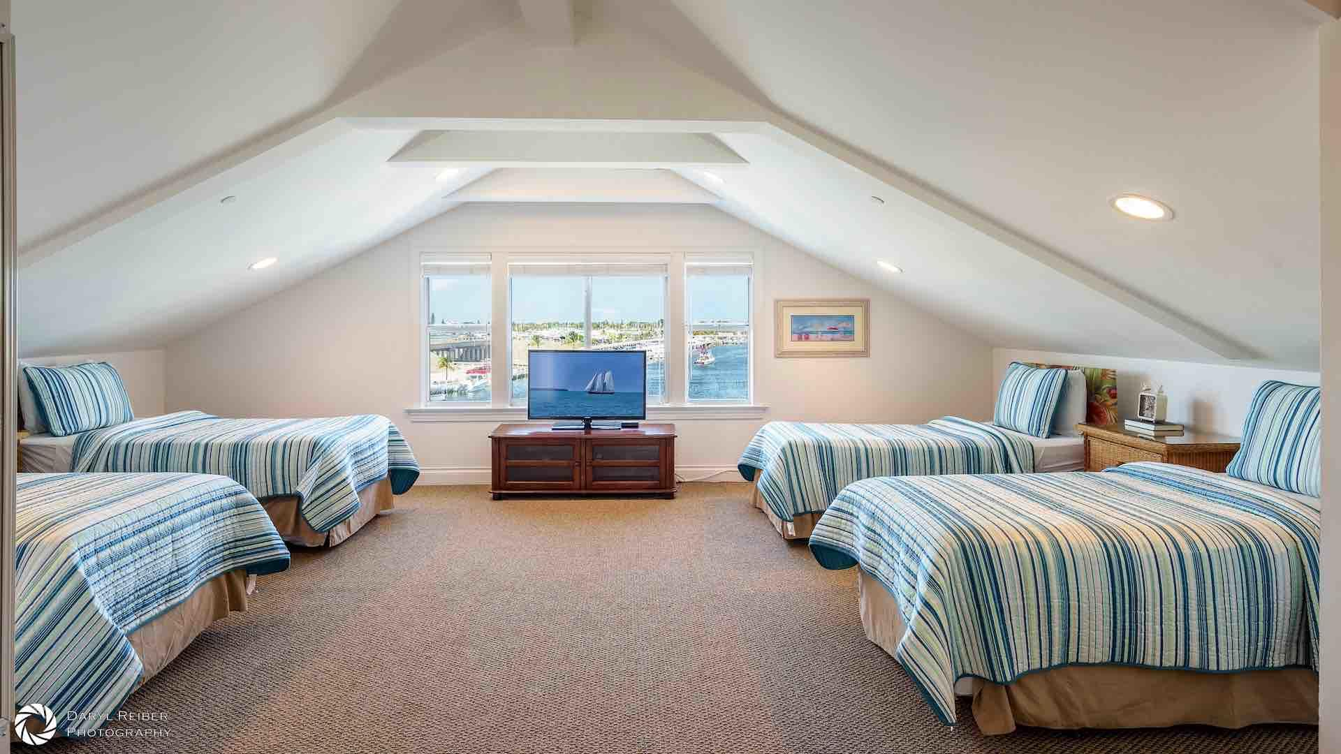 The fifth bedroom has four twin beds that can be converted to two Kings upon request...