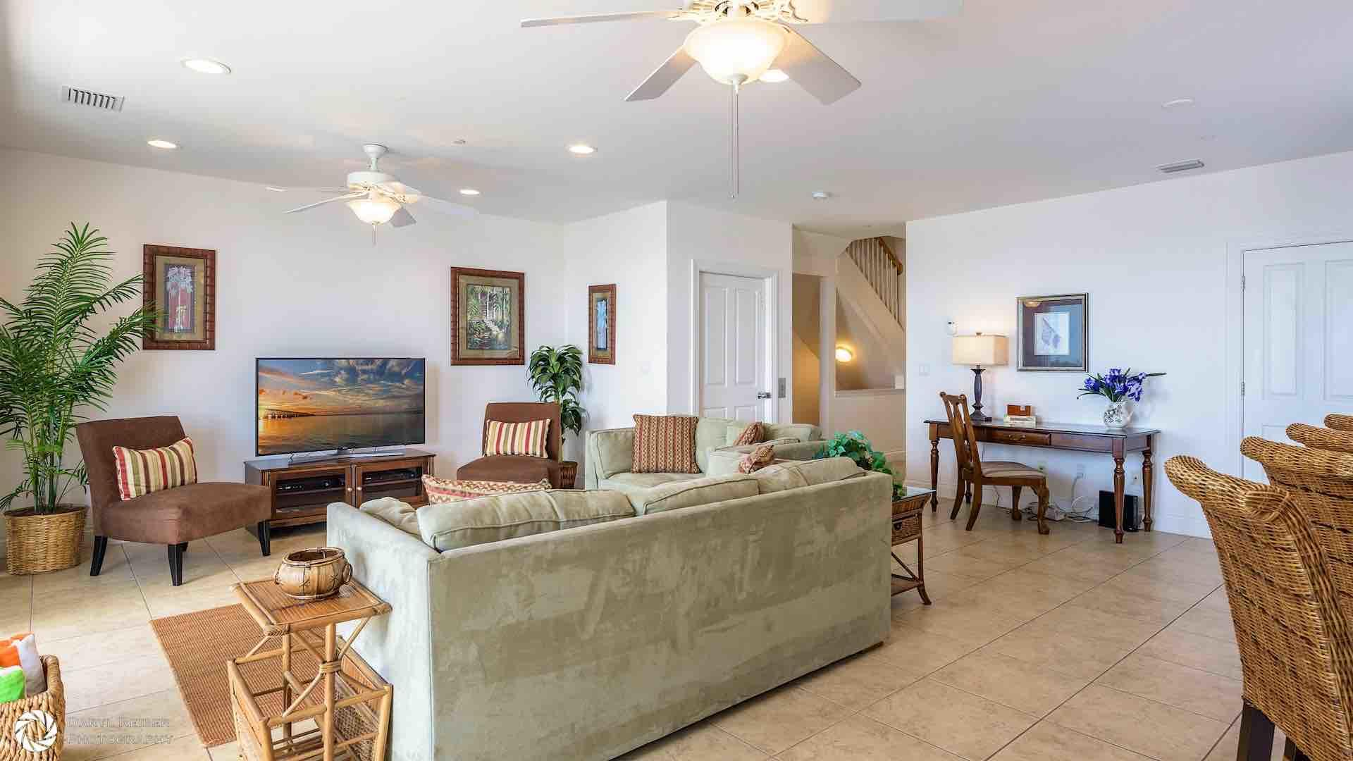 The living area has plenty of room for everyone, with a large HDTV and comfortable seating options...