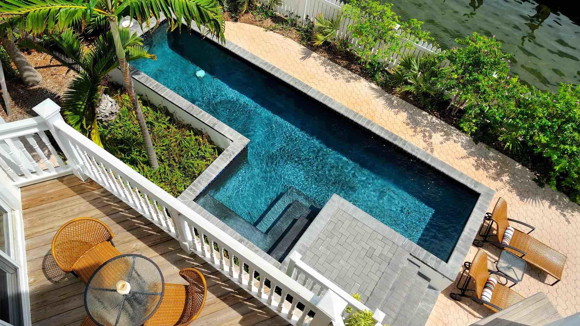 The priavte pool is right on the water and you can access the boat dock through the back gate...